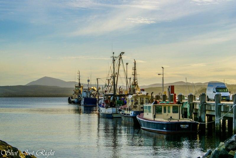 Boats at Snug Bay towards Sunset