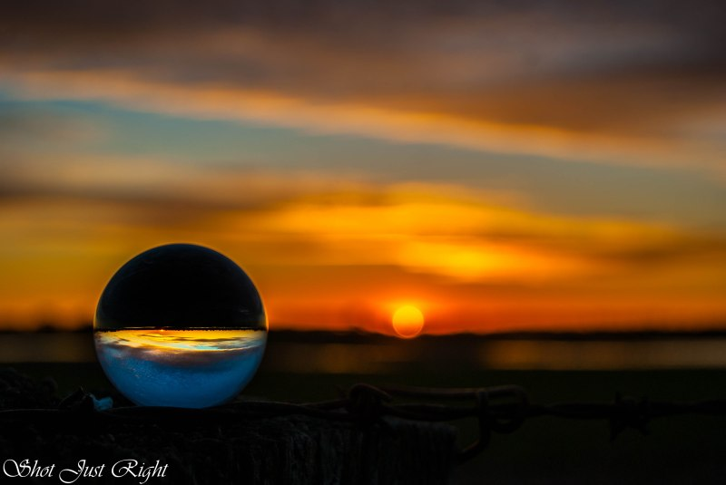 Through a crystal ball with sun behind